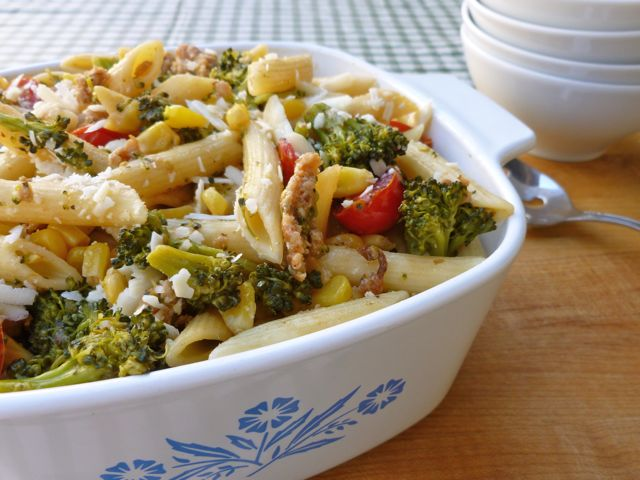 pasta with sausage and vegetables in blue flower corning casserole dish