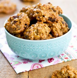 Crispy Raisin Cookies in a blue bowl on a wood table