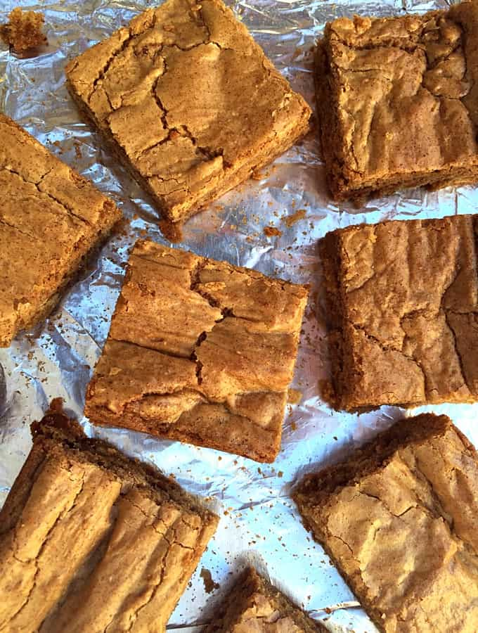 Blonde brownies on foil-wrapped cookie sheet pan.