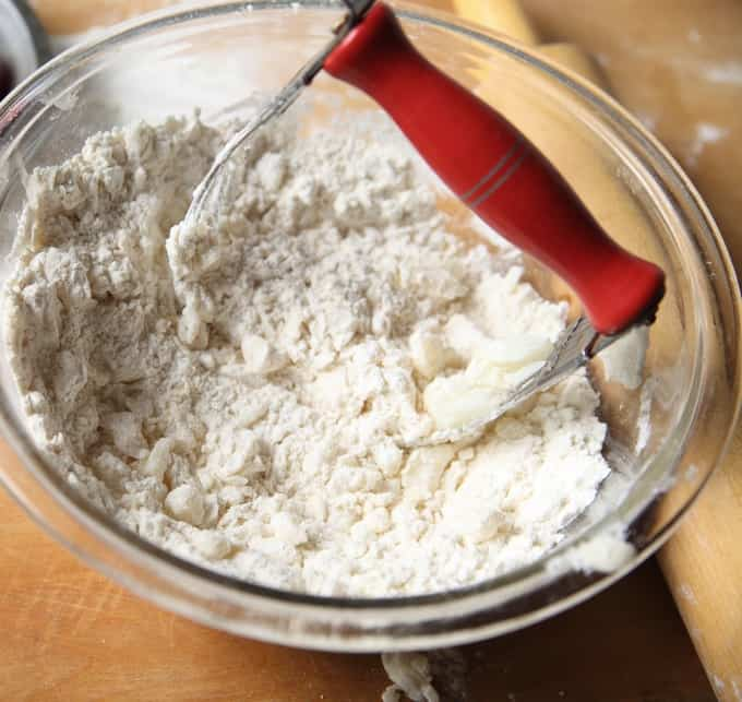 Cutting butter into flour to make cookie dough using a pastry knife