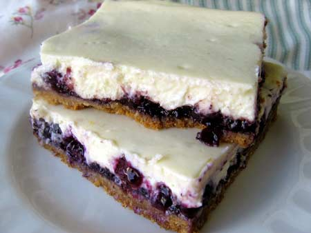 Blueberry Cheesecake Bars Stacked One Atop Another