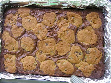 Fresh from the oven pan of chocolate chip cookie dough brownies