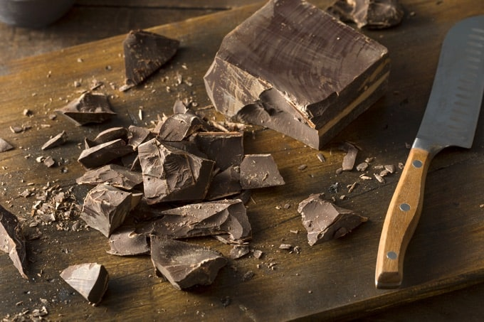 Organic Semi Sweet Dark Chocolate Chunks for Baking on Wooden Table with Clever