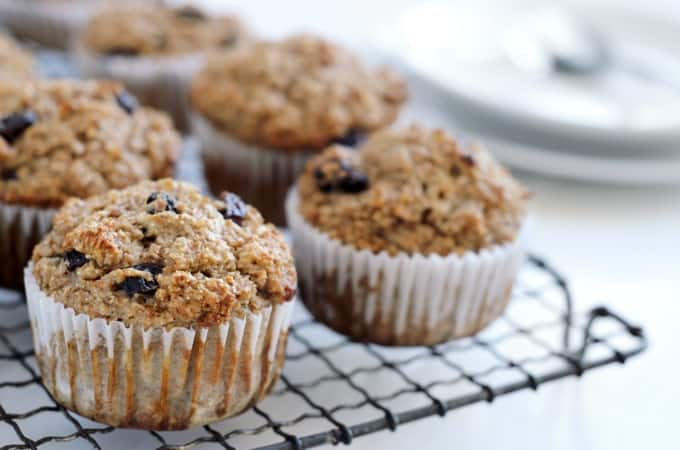 Healthy bran muffins with raisins on cooling rack