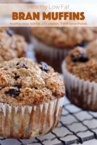 Healthy bran muffins with raisins cooling on wire rack up close.
