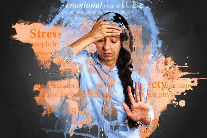Stressed woman with hand on her forehead