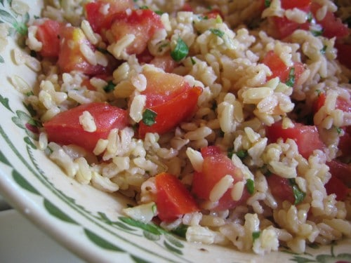 Tomato and brown rice salad with chopped basil up close.