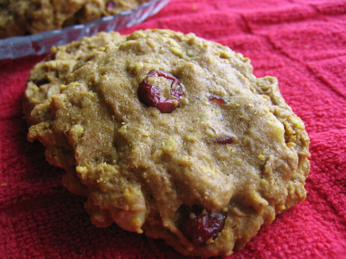 Breakfast cookies with oats and cranberries on red towel.