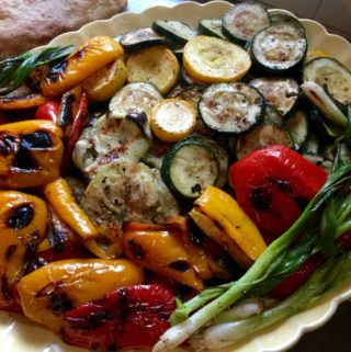Yellow Oval Platter Grilled red peppers, zucchini, squash, scallions