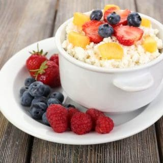 Bowl of Cottage Cheese with Pineapple, Blueberries, Strawberries and Raspberries