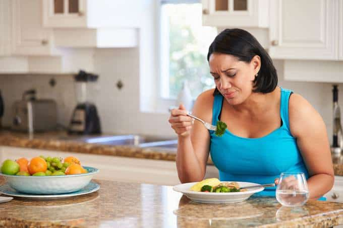 Woman in Kitchen Fed Up with Diet