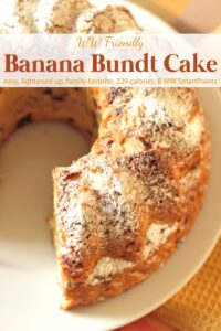 Banana bundt cake dusted with powdered sugar on serving plate.