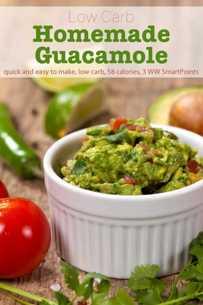 Homemade guacamole with tomatoes, onion, cilantro and jalapeño in small white dish