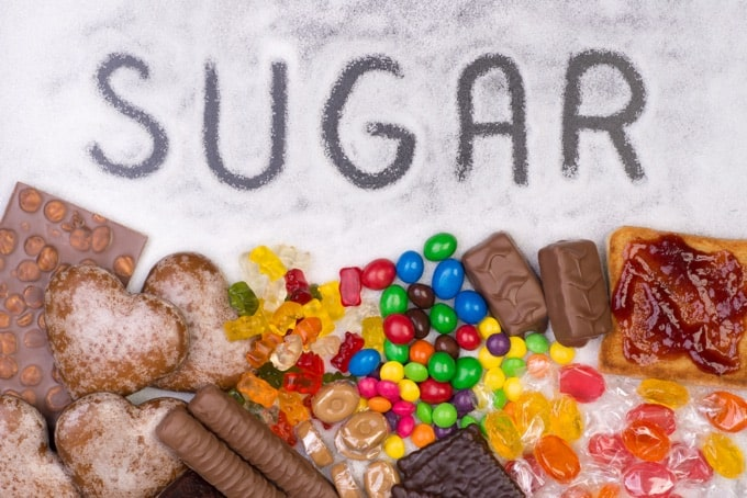 Junk food, candy bars, gummy bears, M&Ms and white sugar