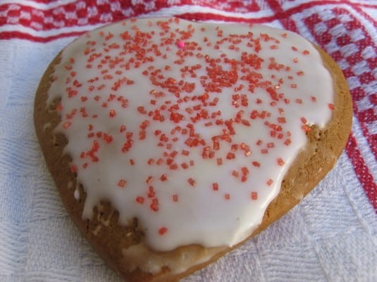 Iced Molasses Heart Cookie with red sugar sprinkles