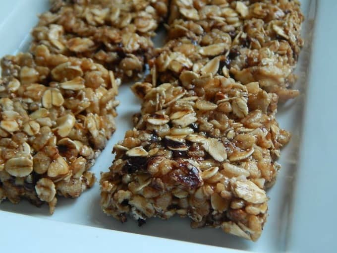 peanut butter chocolate rice krispie granola treats from drizzle me skinny on white plate closeup
