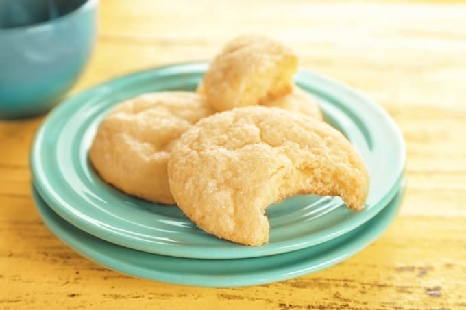 Tasty sugar cookies on a green plate