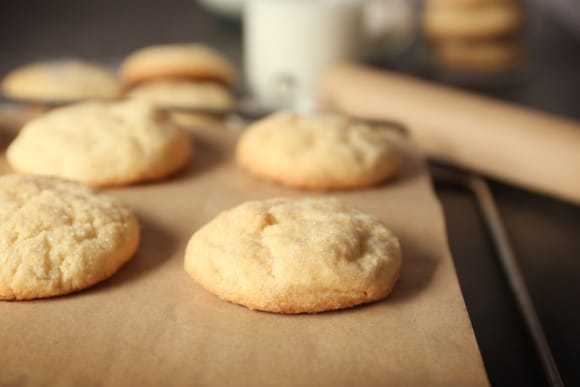 Fresh baked sugar cookies cooling on parchment paper