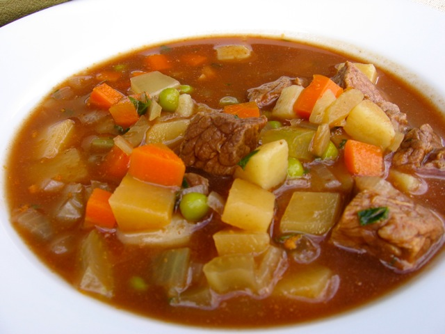 Close Up Hearty Beef & Vegetable Slow Cooker Soup in White Bowl