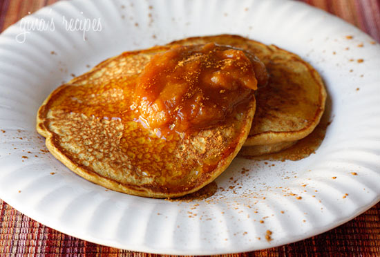 Two pancakes on a white plate topped with pumpkin butter