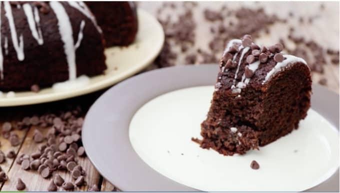 Slice of glazed chocolate-pumpkin bundt cake topped with mini chocolate chips