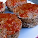 Mini Meat Loaf Muffins on a white plate with red checked napkin