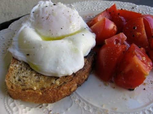 Healthy Poached Egg with Tomatoes on White Plate
