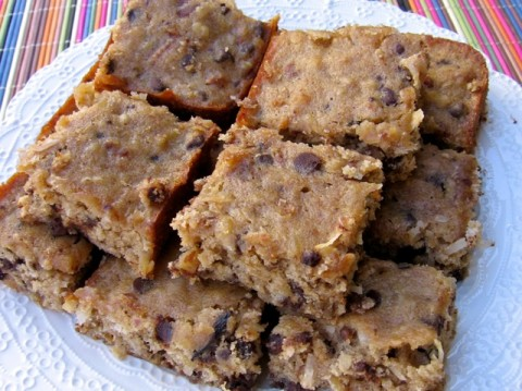 Low Fat Banana Chocolate Chip Cookie Bars stacked on a white serving plate.