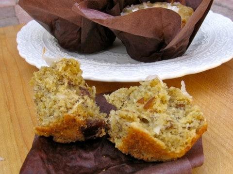 Banana Coconut Date Muffin broken in half on brown napkin