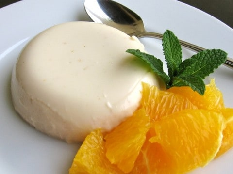 Skinny Panna Cotta topped with Honey & Orange and fresh mint in small glasses with twine bows