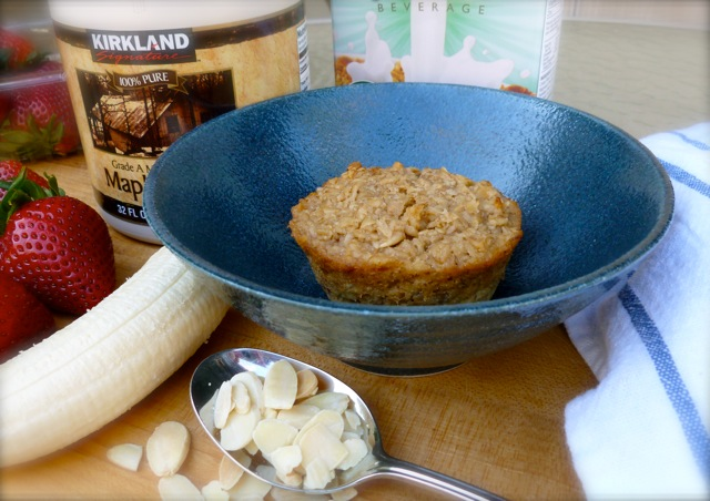 Individual Banana Bread Baked Oatmeal with Bananas, Strawberries and Almonds in a blue bowl