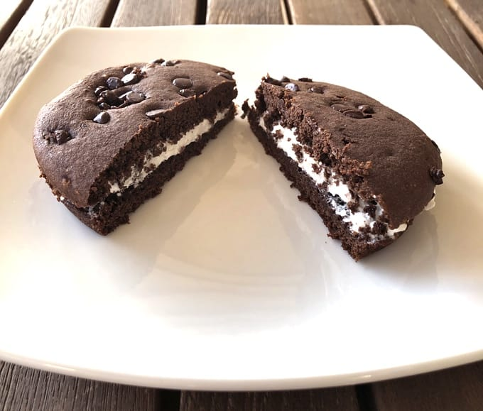 VitaTop Chocolate Whoopie Pie cut in half on white plate