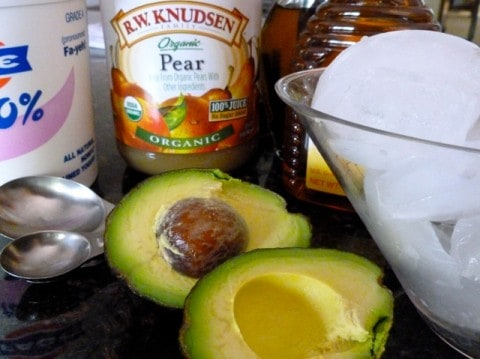 Avocado Pear Smoothie Ingredients including Greek Yogurt, Pear Juice, Avocado, Honey and Ice Cubes