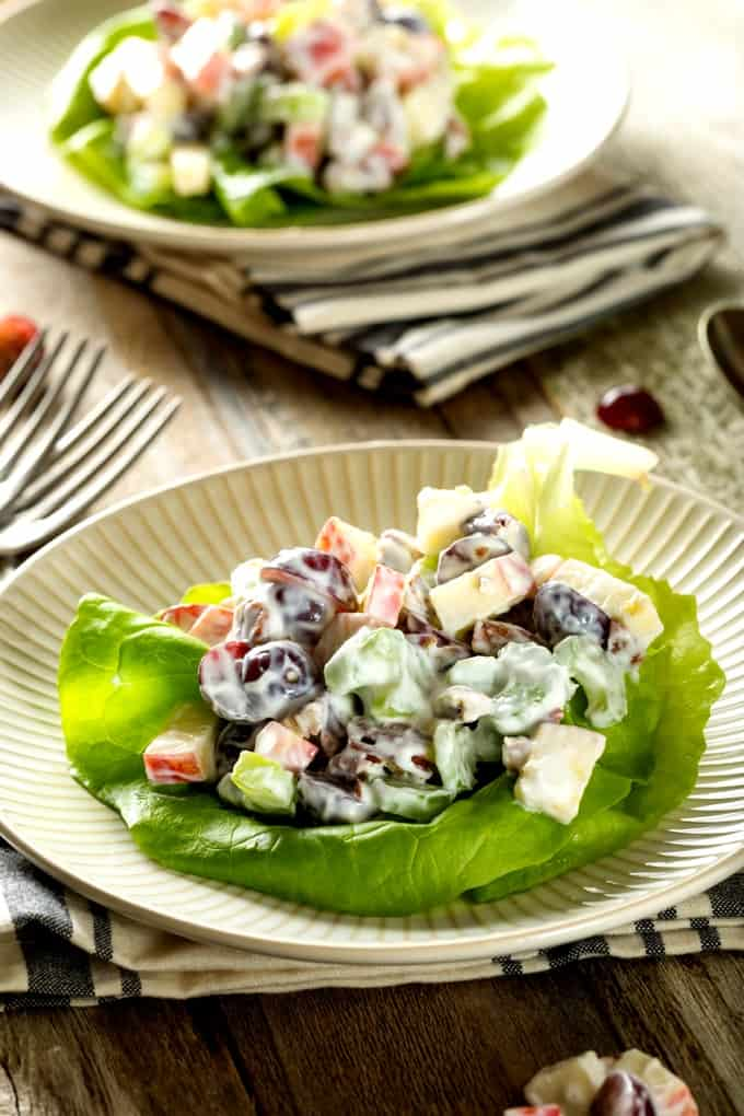Freshly homemade Waldorf salad and lettuce leaf with another Waldorf salad in the background
