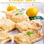 Lemon cream cheesecake bars on parchment paper lined wood cutting board.