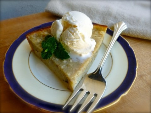 Banana Bread Pie with scoop of vanilla ice cream on plate with fork