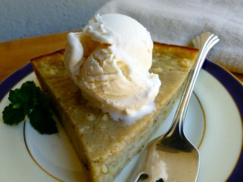 Banana Bread Pie A La Mode on a plate with a scoop of vanilla ice cream