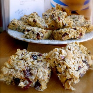 nigella breakfast bars foreground, plate and cookbook background