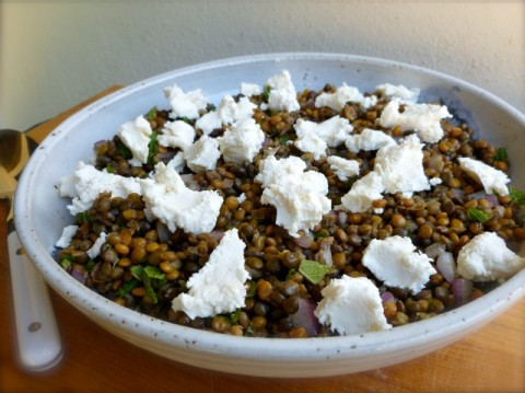 Weight Watchers Lentil Salad with Goat Cheese and Mint in white bowl with serving spoon.