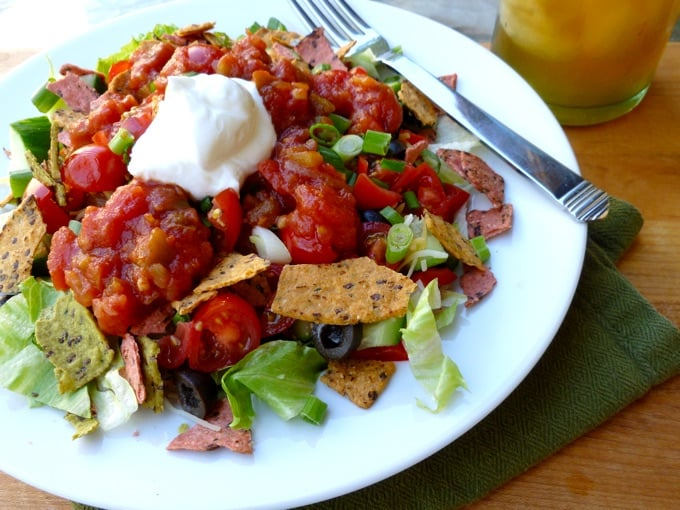 Healthy Taco Salad topped with salsa, tortilla chips and non-fat Greek yogurt