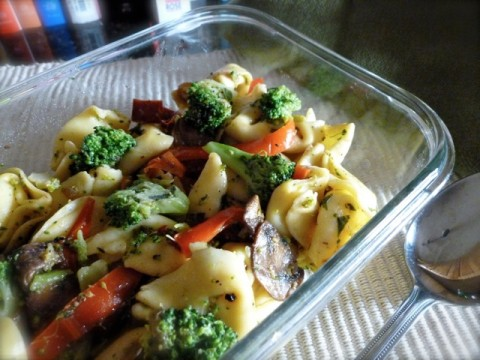 Cheese Tortellini with Broccoli, Mushrooms & Red Peppers in a glass bowl