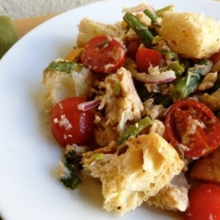 Salmon Panzanella salad on white plate