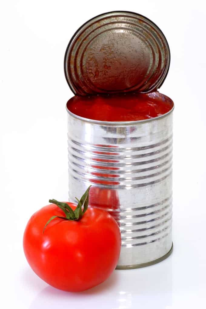 Can of peeled tomatoes on white background