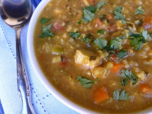 Bowl of Mulligatawny Soup topped with chopped cilantro