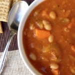Simple Weight Watchers Cabbage Bean Soup from above with spoon and crackers