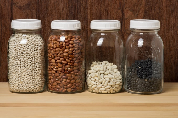 Dry beans stored in glass jars in the kitchen