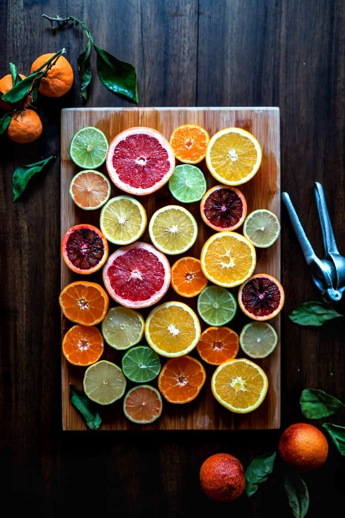 Sliced citrus fruit on a wood cutting board