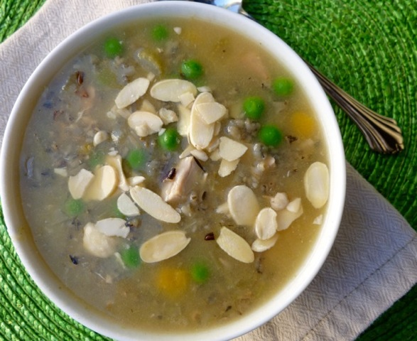 wild rice soup in a white bowl garnished with slivered almonds from above