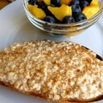 Cottage Cheese on Toast with Cinnamon alongside bowl of blueberries and peaches