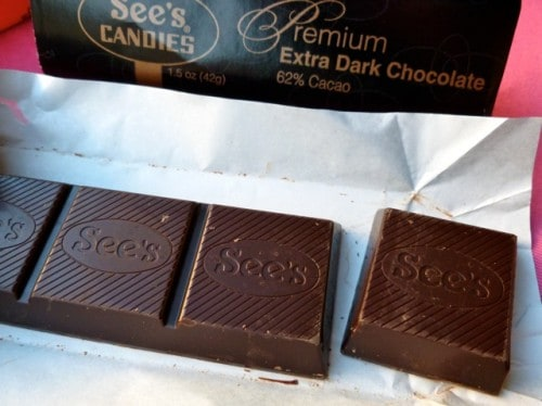Squares of sees dark chocolate with label in background